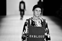 Oxblood fashion show. SYDNEY / AUSTRALIA - 20 May: Model walks on runway during Oxblood show at The Innovators fashion design studio during Mercedes Benz Fashion Stock Photo