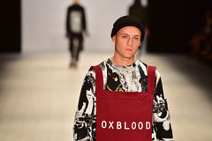 Oxblood fashion show. SYDNEY / AUSTRALIA - 20 May: Model walks on runway during Oxblood show at The Innovators fashion design studio during Mercedes Benz Fashion Stock Image
