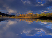 Oxbow in Fall. Aspen and Mt Moran reflect in Oxbow area of Snake River, Grand Teton National Park royalty free stock photography