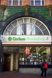 Oxfam Bookshop. Reading, England - January 29, 2015: Person looking at the window display of the Oxfam Bookshop in Reading, England. The original Oxford Royalty Free Stock Photography