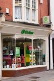 Oxfam compera Fotografie Stock