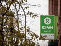 Oxfam logo in front of their local charity shop in Montreal, Quebec. Oxfam is an NGO specialized in fighting poverty. MONTREAL, CANADA - NOVEMBER 6, 2018 royalty free stock photography