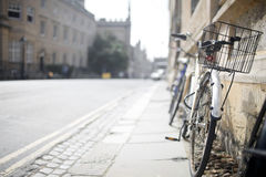 Oxford bicycle. A bicycle leans against a wall in Oxford, UK Royalty Free Stock Photo