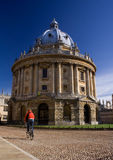 Oxford Radcliffe Camera. Oxford University Radcliffe Camera building, England, with cyclist passing by royalty free stock image