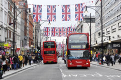 Oxford Street. London May 19. The busy Oxford Street with United kingdom flags Royalty Free Stock Image