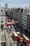 Oxford Street from above. LONDON, UK  JUNE 17, 2014:  View from above overlooking the busy Oxford Street and Oxford Circus with shoppers and buses.  The landmark Stock Images