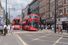 Oxford Street in London, UK. The london bus and shoppers along Oxford Street in London, UK Stock Image