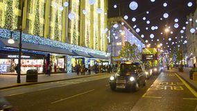 Oxford Street at night before Christmas with Traffic and people in London stock footage