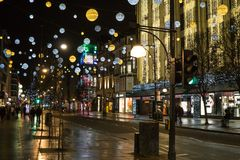 Oxford Street shopping district in London on Boxing Day morning with Christmas lights and decorations. royalty free stock image