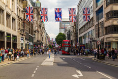 Oxford Street, Union Jack Flags, buses and People Royalty Free Stock Photos