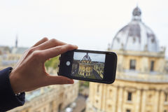 OXFORD/ UK- OCTOBER 26 2016: Tourist Taking Photo Of Radcliffe Camera In Oxford On Phone Stock Image