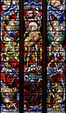 OXFORD, UNITED KINGDOM - AUGUST 22: Stained glass depicting Saint Michael and Angels fighting the dragon. Christ Church Cathedral Royalty Free Stock Photography