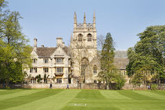 Oxford University Buildings. Historic University Building in Oxford City, England with cricket field in front and Church in the background Stock Image