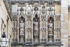 Oxford University England. Detail of three medieval statues in niches on the facade of a historical building in Oxford University campus, England Royalty Free Stock Photo