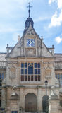 Oxford University England. The facade of a historical building with a clock in in Oxford University campus, England Stock Photography