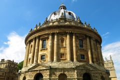 Oxford University Radcliffe Camera Oxford England. The Radcliffe Camera is a circular library and one of Oxford, England's chief landmarks. The crenelated towers Stock Photos