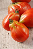 Oxheart tomatoes. On wooden table Royalty Free Stock Image