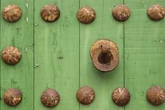 Oxide metal handle on old wood door. Oxide metal handle on old green wood door Royalty Free Stock Image