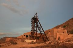 THE OXIDIZED WATCHER. Memories of what was once a mining complex stock photography