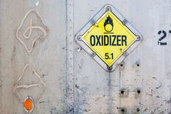 Oxidizer placard on decayed metal container royalty free stock photos