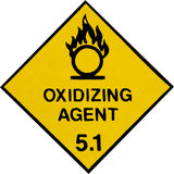 Oxidizing Warning Sign. Yellow warning label for chemicals of dangerous goods class 5.1, oxidizing agents Royalty Free Stock Photos