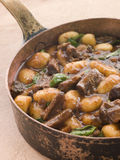 Oxtail Braised in Red Wine with Basil Gnocchi Stock Photos