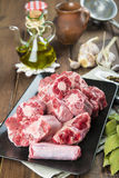 Oxtail and with olive oil and ingredients to cook it Royalty Free Stock Photos