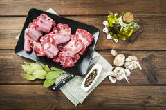 Oxtail and with olive oil and ingredients to cook it Stock Photo