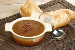 Oxtail soup. Hot oxtail soup in rustic bowl on a wooden table Stock Photos