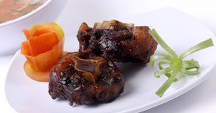 Oxtail soup on a white plate for design material stock images