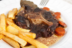 Oxtail stew with carrots and fries Stock Image