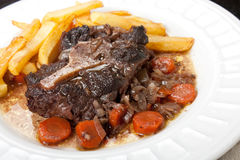 Oxtail stew with carrots and fries Royalty Free Stock Images