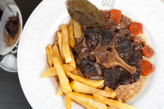 Oxtail stew with carrots and fries Stock Photography