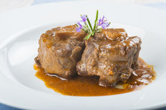 Oxtail stew decorated with rosemary flowers Royalty Free Stock Image