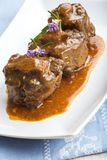 Oxtail stew decorated with rosemary flowers Stock Photos