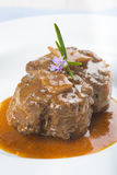 Oxtail stew decorated with rosemary flowers Stock Photo