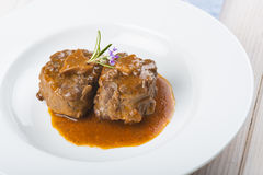 Oxtail stew decorated with rosemary flowers Stock Image