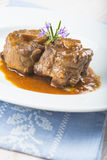 Oxtail stew decorated with rosemary flowers Royalty Free Stock Photography