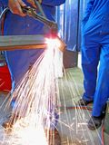 Oxy fuel cutting. A welder cutting up metal using oxyaceteylene  cutting torch Royalty Free Stock Photography
