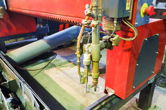 Oxy-fuel torches of CNC cutting machine. In mechanical shop Stock Photo