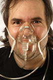 Oxygen. A male breathing through an oxygen mask with odd expression on his face stock photo