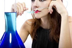 Oxygen Bar. Woman inhaling flavored oxygen with cannula and scented water royalty free stock photos