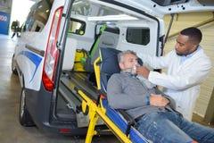 Oxygen mask male patient ambulance stretcher emergency transport hospital. Amulance royalty free stock image