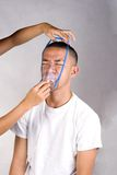 Oxygen mask and patient. Proper placement on of a mask on patient royalty free stock photography