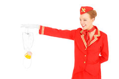 Oxygen mask. A picture of an attractive stewardess presenting an oxygen mask over white background royalty free stock photo