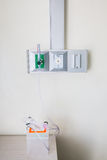 Oxygen piping and regulator with flow meter. Royalty Free Stock Photography
