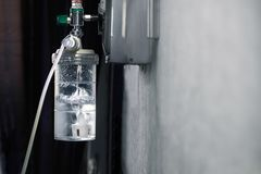 Oxygen regulator with humidifier medical equipment. At hospital room stock image