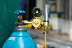 Oxygen Tank with an Argon Flowmeter for Stainless Steel Welding. Work royalty free stock photography