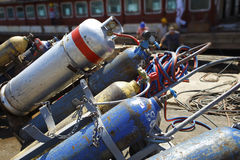 Oxygen and tanks for welding. Several tanks or cylinders of oxygen and acetylene used for welding at a constructions site Royalty Free Stock Photography
