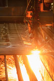 Oxygen torch cuts steel sheet. Stock Photo